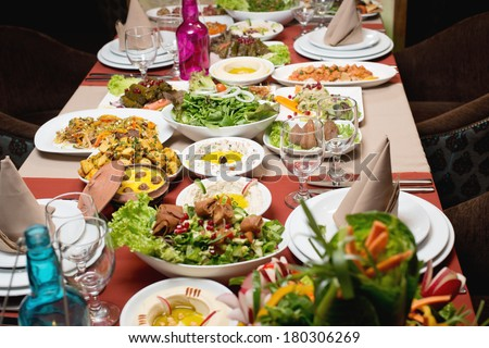 Table with various arabic food served  - stock photo
