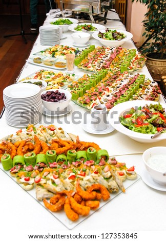 Table with various delicious appetizer - stock photo