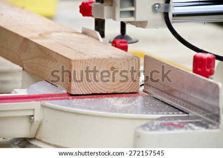 table with wooden plank and instrument tools at joiner's shop - stock photo