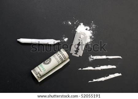 Tableau of drugs :cocaine, razor, cocaine lines, one dollar, joint - stock photo