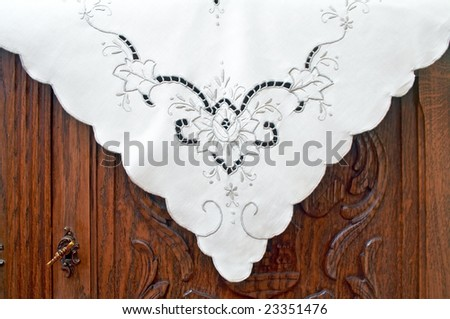 Tablecloth on the old dresser - stock photo