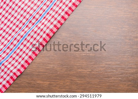 Tablecloth on wooden background with copy space