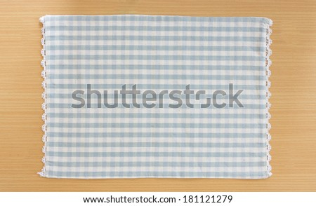 Tablecloth on wooden table - stock photo