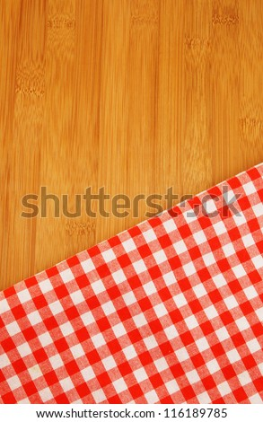 Tablecloth on wooden table background - stock photo