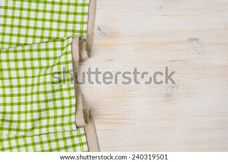 Tablecloth textile on bleached wooden background - stock photo