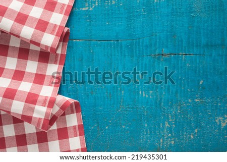 Tablecloth textile on old wooden background   - stock photo