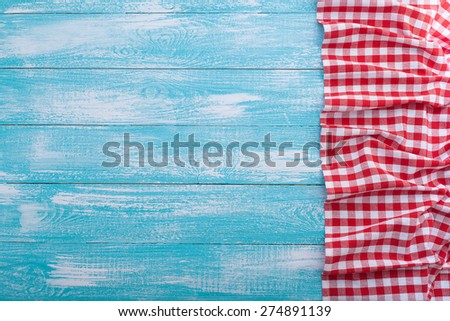Tablecloth textile on tiffany blue wooden background  - stock photo