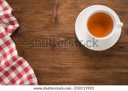 Tablecloth textile with teacup on the table - stock photo