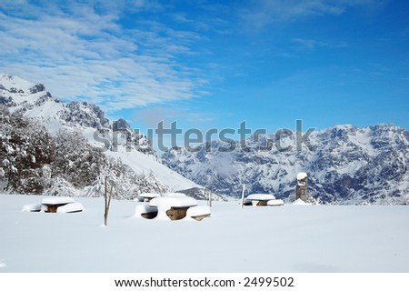 Tables and benches with snow - stock photo
