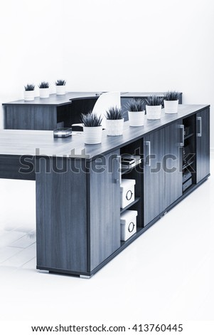 tables and cabinets against a white wall - stock photo