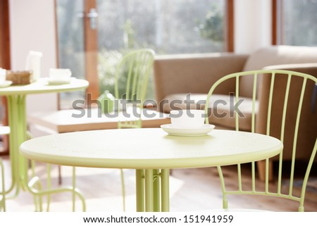 Tables And Chair In Empty Cafe - stock photo