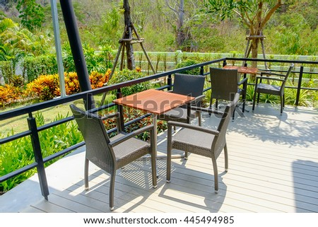 Tables And Chair In Empty Cafe, restaurant, fast food and coffee shop, near garden - stock photo