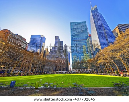 Tables and chairs and Skyscrapers viewed from Bryant Park in Midtown Manhattan, New York, USA. Tourists relaxing in the park - stock photo
