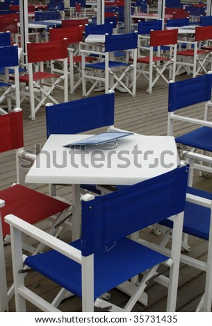 tables and chairs at a bar