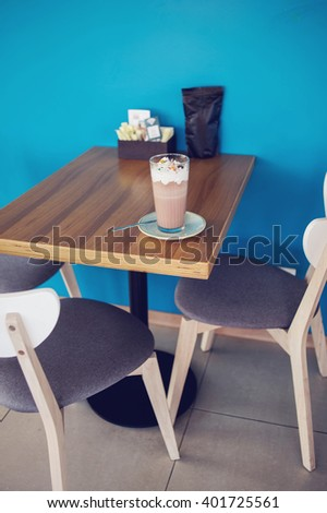 Tables and chairs at intdoor cafe. Meeting place in cafe, interior of restaurant. - stock photo