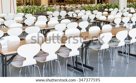 Tables and chairs empty in canteen - stock photo