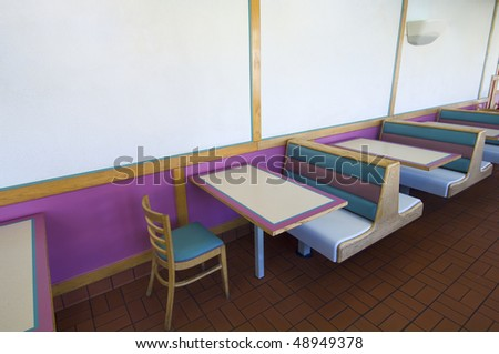 tables and chairs in a fast food restaurant