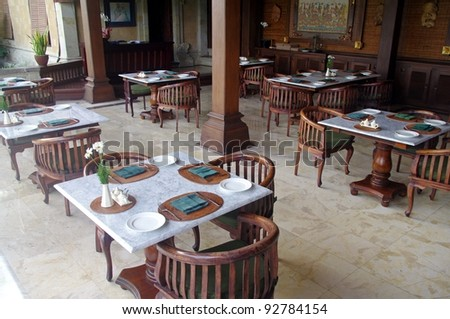 Tables and chairs in a restaurant, Ubud, Bali, Indonesia. - stock photo