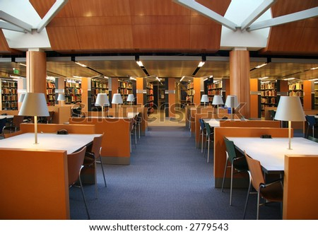 Tables and chairs in an empty library - stock photo