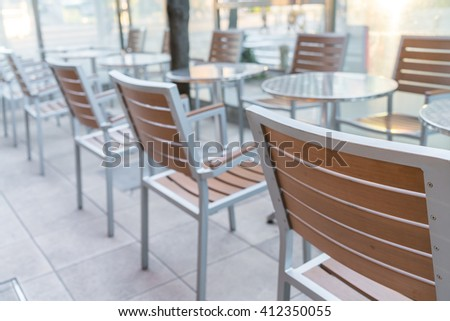Tables and chairs in restaurant - stock photo