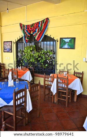 Tables and chairs inside an Mexican restaurant - stock photo