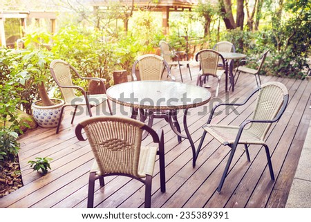 Tables and chairs of cafeteria outside in garden - stock photo