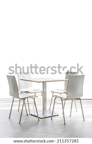 tables and chairs set on floor isolated on white background - stock photo
