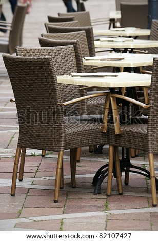 Tables and rattan chairs - stock photo
