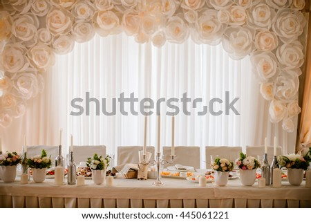 Tables decor in the restaurant on wedding day. Pastel decorations, indoor - stock photo