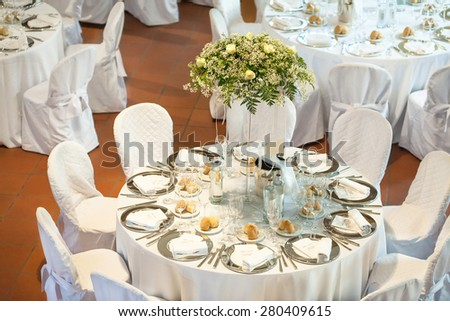 Tables decorated for a party or wedding reception - stock photo
