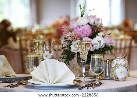 tables set for fine dining during a wedding event. Shallow depth of field, focus on items in the foreground - stock photo