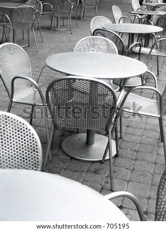 tables with chairs outside - stock photo