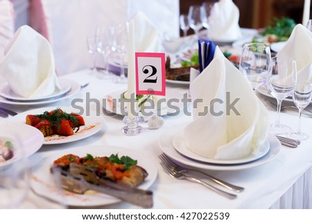 Tables with food served for a festive dinner - stock photo