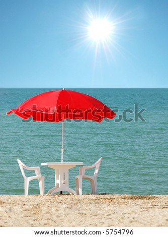Tables with parasol at summer beach