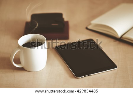 Tablet and coffee on a desk