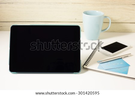 Tablet and credit card with smartphone for online banking and payment concept
