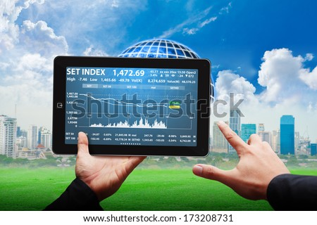 Tablet and graph report : Elements of this image furnished by NASA
