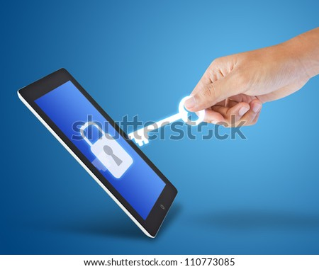 Tablet and key - stock photo