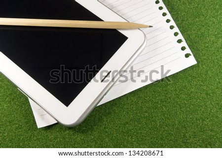 Tablet and line blank papers - stock photo