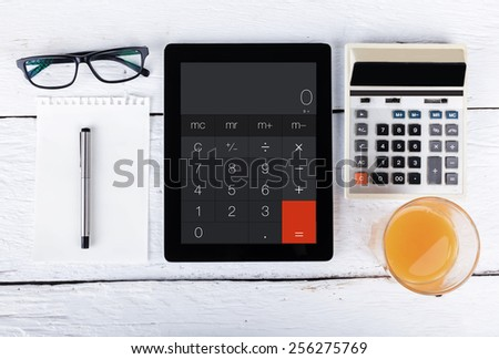 Tablet and smartphone  as a calculator - stock photo