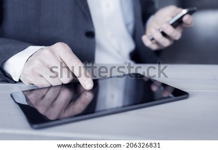 Tablet and smartphone user - stock photo