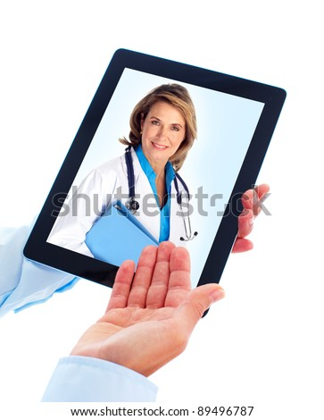 Tablet computer and doctor woman. Health care. Isolated on white background. - stock photo