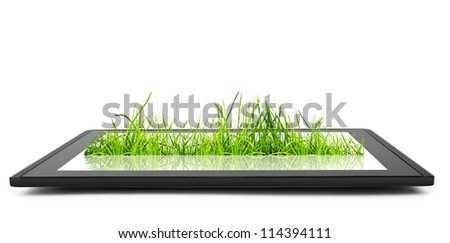tablet computer and grasss  on the white backgrounds. - stock photo