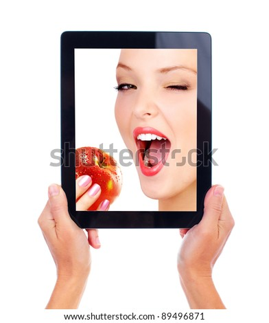 Tablet computer and woman with apple. Isolated on white background. - stock photo