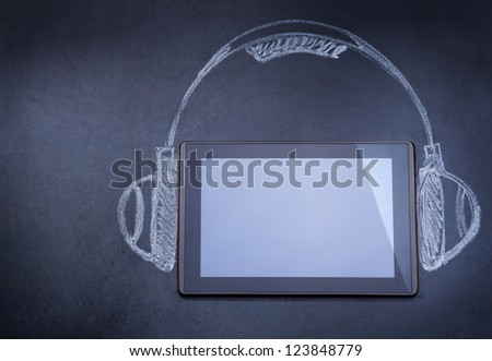 Tablet computer as audio player on the blackboard with tripod and strobe drawn with chalk - stock photo