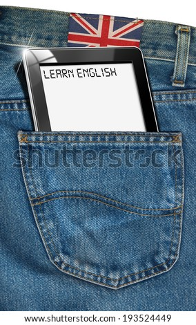 """Tablet Computer - English Everywhere / Blue jeans fabric with black tablet computer with phrase """"learn english"""" in a pocket and label with uk flag - concept to speak english everywhere - stock photo"""