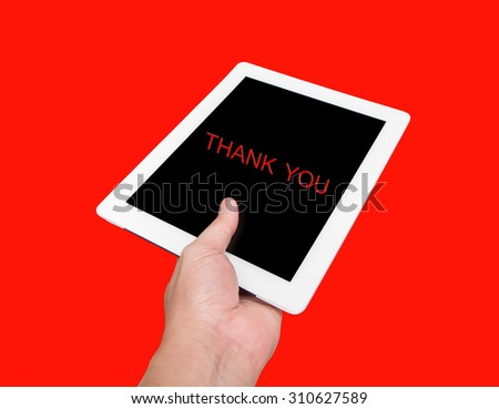 tablet computer isolated in a hand like ipades on the red backgrounds. - stock photo