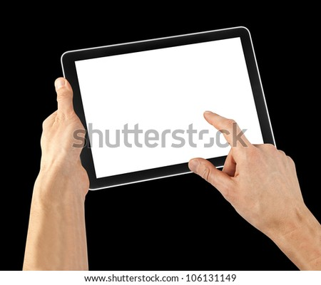 tablet computer isolated in a hand on the black backgrounds.  - stock photo