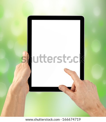 tablet computer isolated in a hand on the white backgrounds. - stock photo