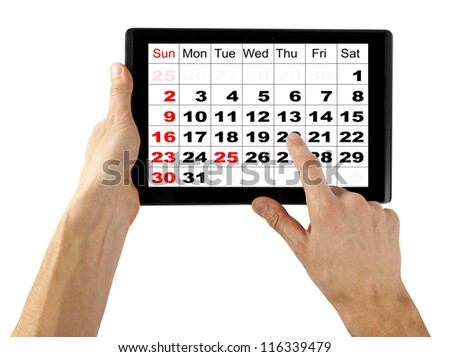 tablet computer isolated in a hand on the white backgrounds. like ipade pc, calendar December 2012 - stock photo